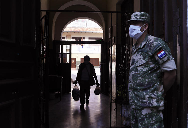 A soldier is seen in Asuncion, Paraguay, on April 22, 2020. Two Paraguayan journalists were recently targeted by hackers who stole information from their phones. (AP/Jorge Saenz)