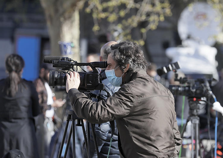 Journalists are seen in London on April 7, 2020. CPJ recently partnered with groups launching surveys to track the COVID-19 pandemic's impact on journalism. (AP/Kirsty Wigglesworth)