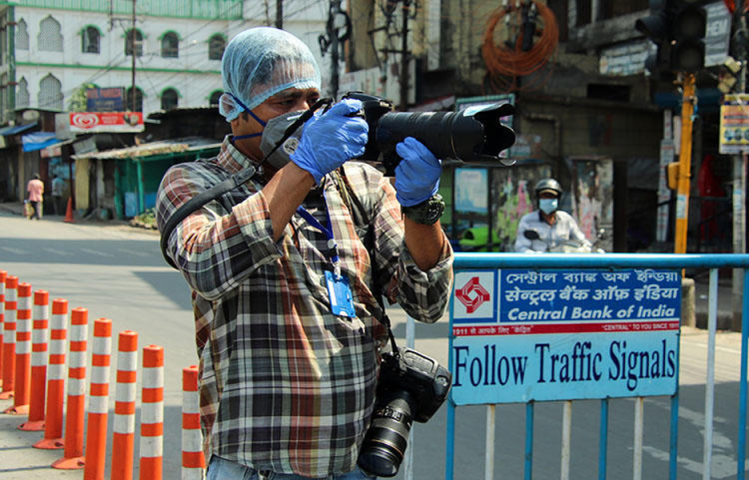AFP photographer Diptendu Dutta works during a government-imposed nationwide lockdown as a preventive measure against the spread of COVID-19 in Siliguri, India, on April 10, 2020. (AFP)