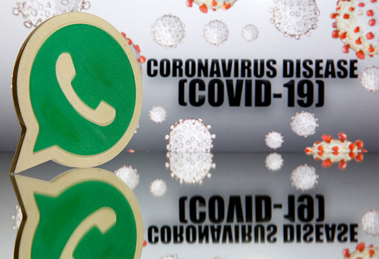 A 3D-printed WhatsApp logo is seen in front of displayed coronavirus disease (COVID-19) sign in this illustration taken March 19, 2020. (Reuters/Dado Ruvic/Illustration)