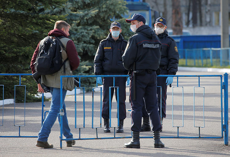 Security guards are seen in Borisov, Belarus, on April 24, 2020. Belarus recently cancelled the accreditations for two journalists covering COVID-19. (Reuters/Vasily Fedosenko)