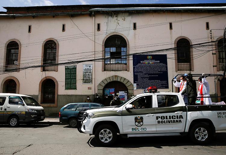 Police are seen in La Paz, Bolivia, on April 5, 2020. Bolivian cartoonist Abel Bellido Córdoba recently received death threats for his work. (Reutesr/David Mercado)