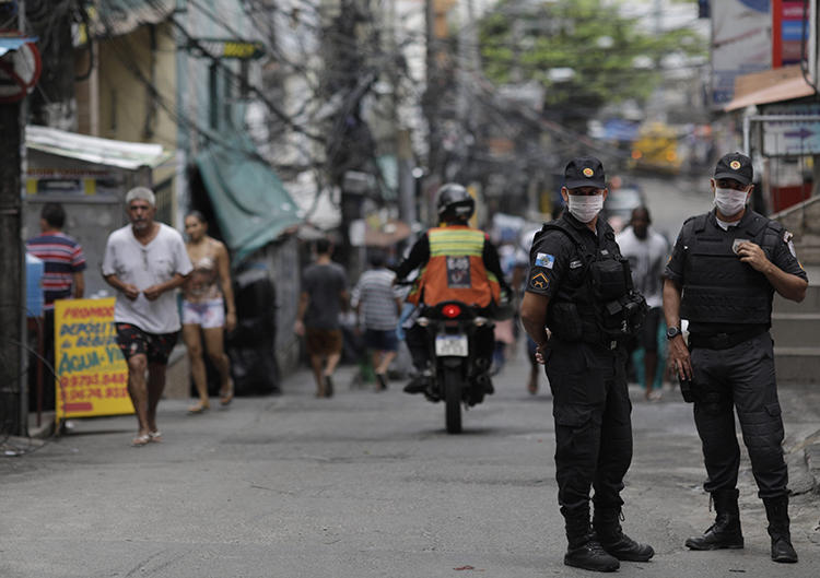 Police officers are seen in Rio de Janeiro, Brazil, on April 10, 2020. Radio journalist Fábio Márcio recently survived a shooting attempt in Piritiba. (Reuters/Ricardo Moraes)