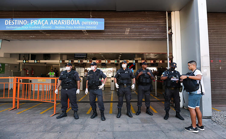 Police officers are seen in Rio de Janeiro, Brazil, on March 23, 2020. Journalist Leonardo Pinheiro was recently shot and killed in Rio de Janeiro state. (Reuters/Sergio Moraes)
