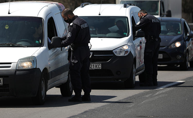 Police officers are seen in Sofia, Bulgaria, April 17, 2020. Police recently journalist Dimiter Petzov for alleged drug posession after searching his car. (Reuters/Stoyan Nenov)