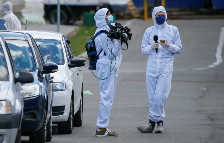 Journalists in protective gear