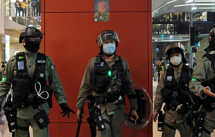 Police are seen in Hong Kong on April 26, 2020. Police recently arrested two journalists for alleged loitering. (Reuters/Tyrone Siu)
