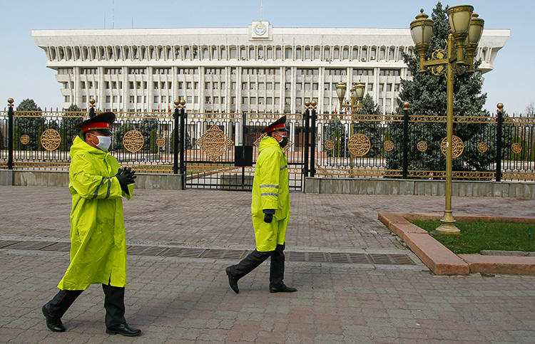Law enforcement officers are seen in Bishkek, Kyrgyzstan, on March 26, 2020. CPJ recently joined a letter expressing concern over media restrictions in the country. (Reuters/Vladimir Pirogov)