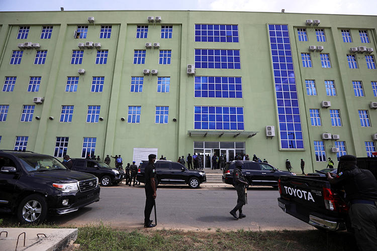 Security officers are seen in Abuja, Nigeria, on May 11, 2020. Department of State Services agents recently detained and interrogated journalist Saint Mienpamo Onitsha. (Reuters/Afolabi Sotunde)