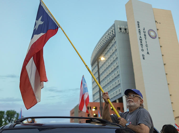 Protesters are seen in front of the Department of Justice in San Juan, Puerto Rico, on July 29, 2019. The department recently subpoenaed Facebook for information from student news outlets on the island. (Angel Valentin/Getty Images via AFP)