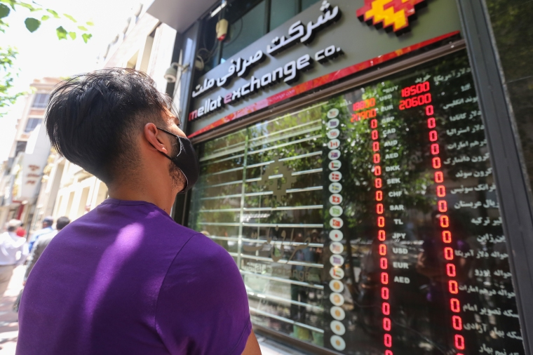 Iranian youth checks currency rates