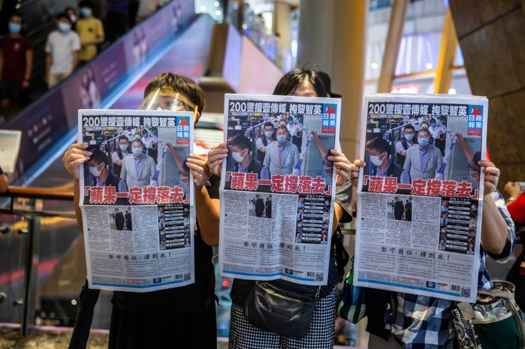 Hong Kong people hold Apple Daily newspaper