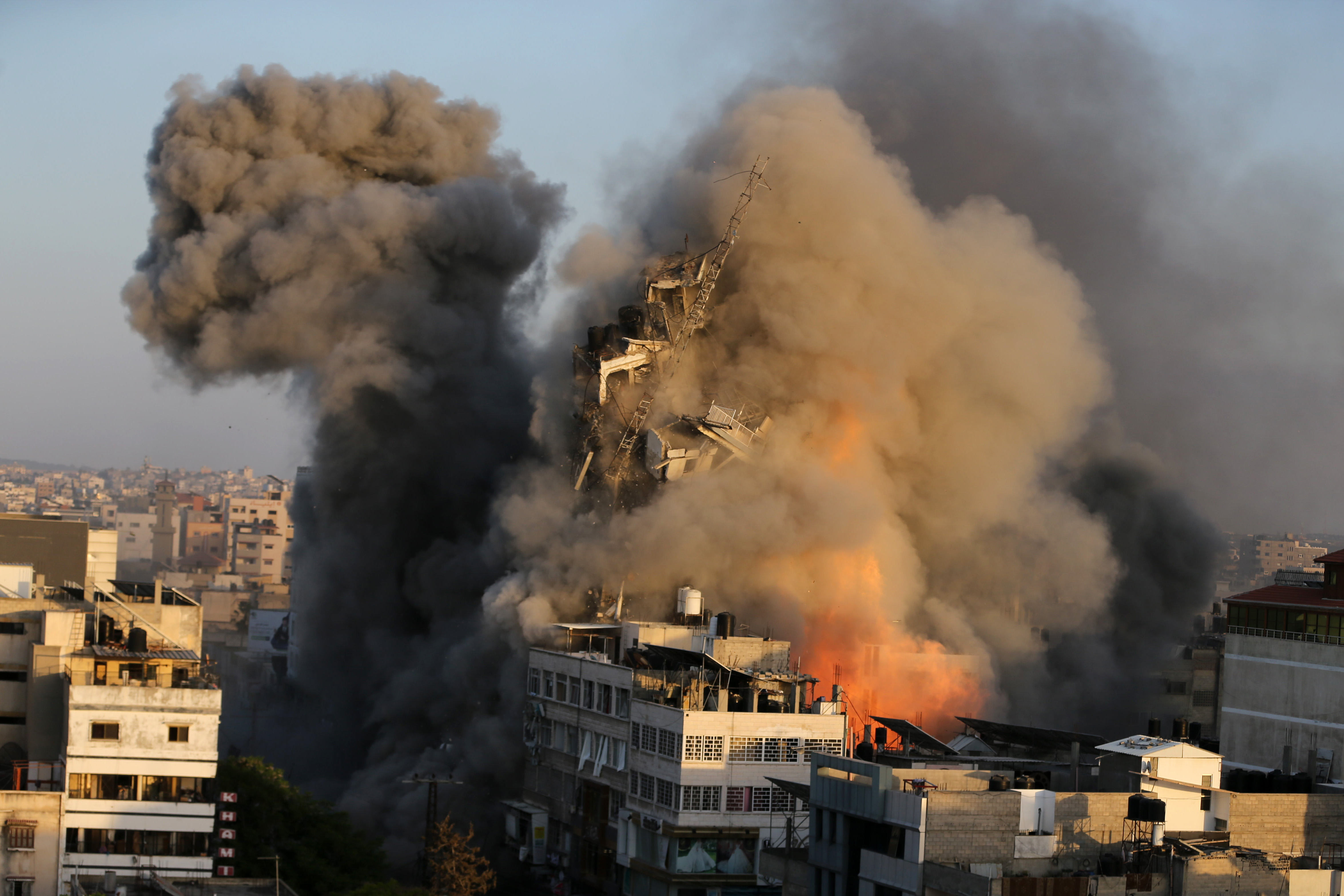 Israeli air strikes destroy buildings housing more than a dozen media outlets in Gaza