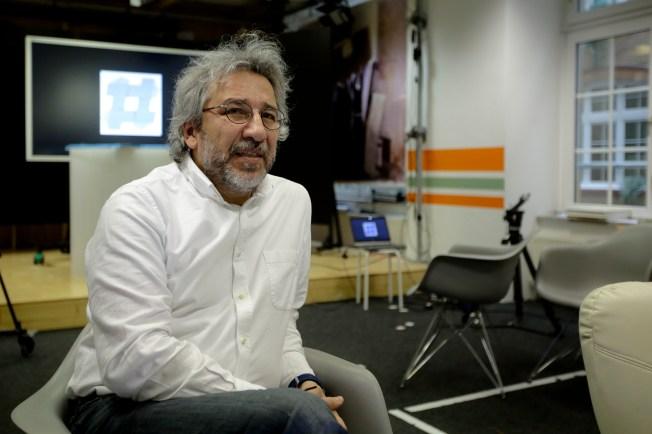 Turkish editor Can Dündar sitting in chair